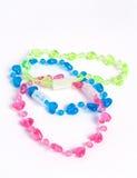 Girl´s plastic bracelet Stock Photo