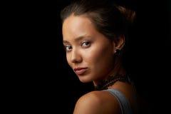 Girl's portrain on black background Stock Photos