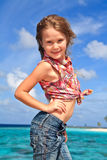 Girl's portrait. Little girl posing on the beach during her tropical vacation Royalty Free Stock Images