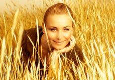 Girl's portrait in golden wheat Stock Photos