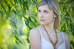 Girl's portrait in the leaves Royalty Free Stock Image