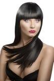 Girl's portrait with long dark hair, slightly turn Royalty Free Stock Photos