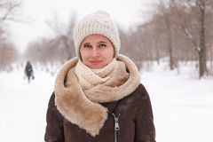 The girl`s portrait in the winter in the park Stock Images