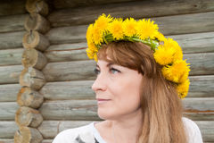The girl`s portrait with a wreath from dandelions Royalty Free Stock Photography