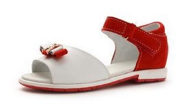 Girl's red and white sandal Stock Photography