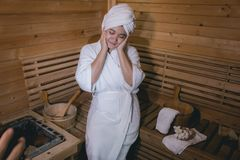 Girl`s in the Sauna room , Refreshing in tropical wood room. To royalty free stock photography