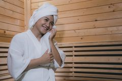 Girl`s in the Sauna room , Refreshing in tropical wood room. To royalty free stock images