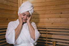 Girl`s in the Sauna room , Refreshing in tropical wood room. To keep the body healthy stock photo