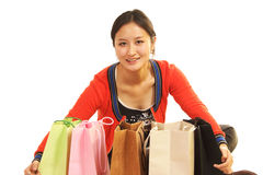 Girl's shopping bag. Happy girls embrace their own gifts stock images