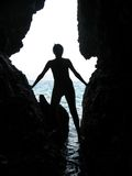 Girl's silhouette in cave Royalty Free Stock Photo