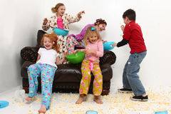 Girl's Slumber Party Sleepover Having Food Fight Royalty Free Stock Images