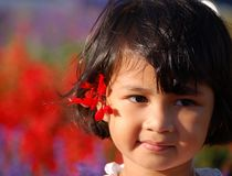 Girl's Smile. Portrait of an asian girl smiling with salvia at ear Stock Photo