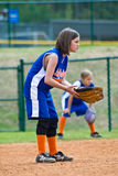 Girl's Softball / Outfielders. Young girls (8 years old) playing their positions during a softball game. This is a regular season game of the Lady Gators vs the Stock Images