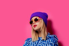 Girl in 90s sports jacket and hat with sunglasses stock images