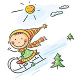 Girl's winter activities: sledging Royalty Free Stock Photos