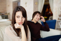 Girl is sad because a guy talking on his cell Royalty Free Stock Image
