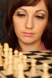 Girl with the sad looks on the chessboard. Stock Photography