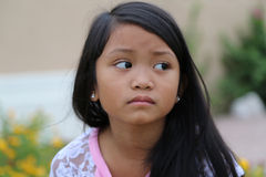 Girl Sad. Minority girl with a sad face looking off day dreaming Stock Image