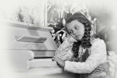 Girl sad about  piano Stock Photo