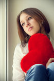The girl is sad, sadness due the guy, keep heart. Sit near the window Royalty Free Stock Photography