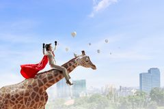 Girl saddle giraffe . Mixed media Royalty Free Stock Photos