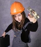 Girl in safety helmet orange vest holding hammer tool Royalty Free Stock Photos
