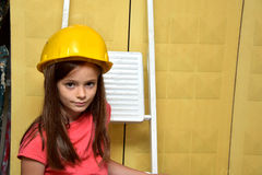 Girl with safety helmet Royalty Free Stock Photography