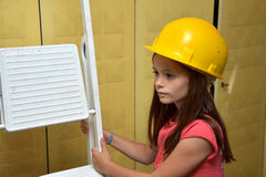 Girl with safety helmet Stock Photos