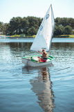 The girl in sailboat on the lake. Royalty Free Stock Image