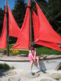 Girl in sailboat. The girl at the sailboat in the Park royalty free stock photo