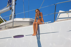 Girl on the sailboat. Girl sitting on the sailboat Stock Images
