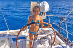Girl on the sailboat. Girl on the wheel on the sailboat Royalty Free Stock Image