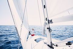 Girl on sailboat royalty free stock image