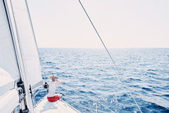 Girl on sailboat royalty free stock images