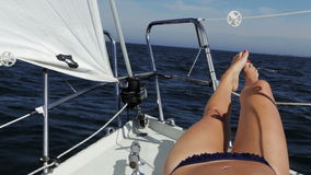 Girl on sailboat stock video