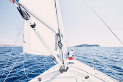 Girl on sailboat stock photos