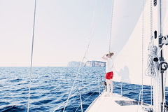 Girl on sailboat stock image