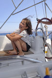 Girl on a sailing boat Stock Photo