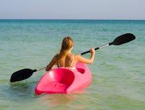 Girl  sailing a kayak Royalty Free Stock Image