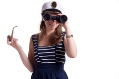 A girl in a sailor cap holding a pipe for smoking Royalty Free Stock Photography