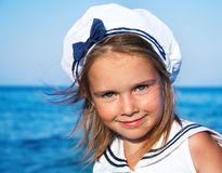 Girl in sailor clothing Stock Photography