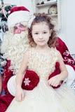 Girl and Saint Nicolas Royalty Free Stock Photos