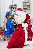 Girl and Saint Nicolas Stock Images