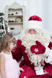 Girl and Saint Nicolas Stock Photos