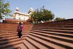 Girl on saircase. Girl on the staircase in front of Jaswant Thada temple in India Royalty Free Stock Photos