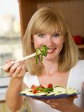 The girl with salad Stock Images