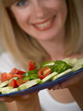 The girl with salad Stock Photography