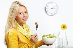 Girl with salad Stock Images