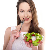 Girl with salad Royalty Free Stock Photo