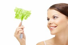 Girl and salad leaf Royalty Free Stock Images